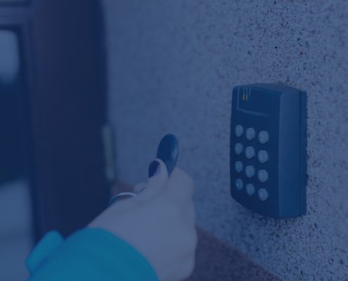 Woman using access control panel and fob